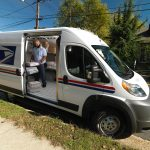 Letter Carrier WIlliam Velez inside new Promaster Van